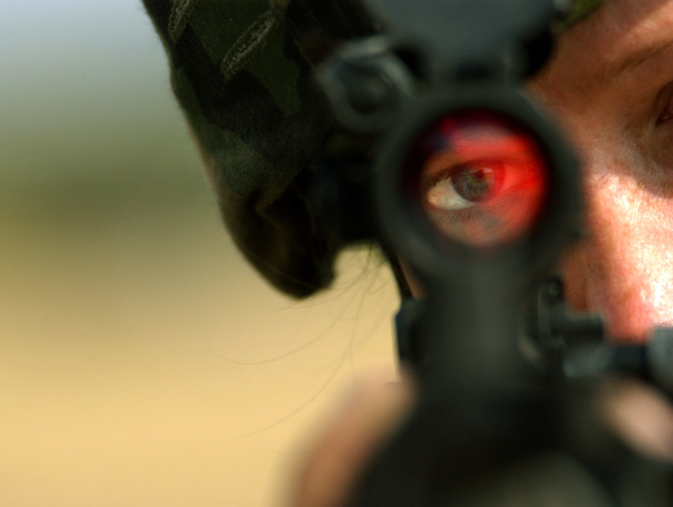 soldier looking  on scope for pop up target