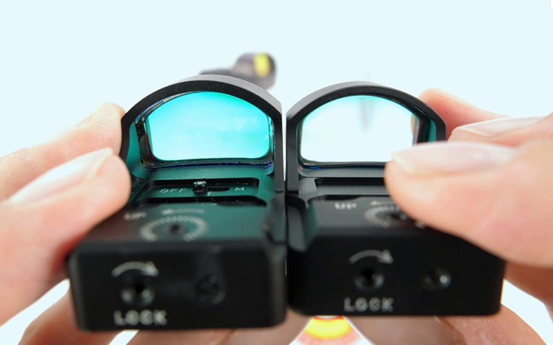 close-up photo of two sight scopes being compared